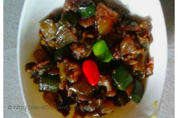 photo of macher tel diye begun (brinjal with fish fat or fish liver)
