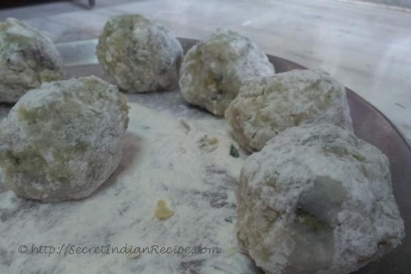 photo of kacche papite ka kofta (raw papaya dumplings in gravy)