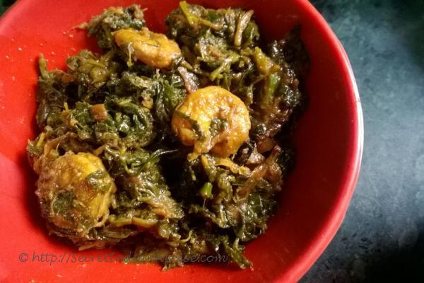 photo of saag chingri (prawns cooked with red spinach)