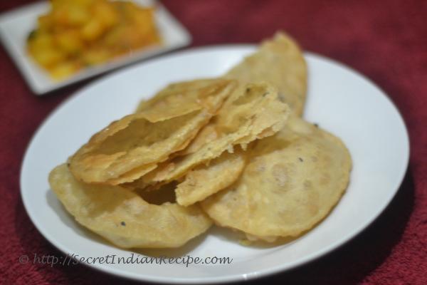 photo of urad dal ki kachori (lentil stuffed deep fried indian bread)