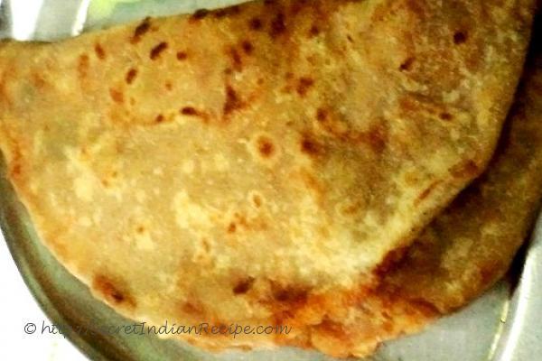 photo of badami aloo paratha (chapatti with potato and crushed potato filling
