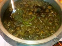 photo of noroxinho aru boror anja (lentil dumplings in curry leaves curry)