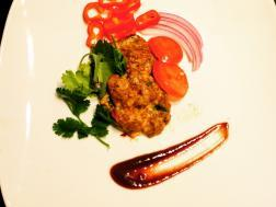 photo of parsley parmesan chicken tikka